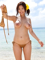 Large breasted Maki Kokoro posing outside