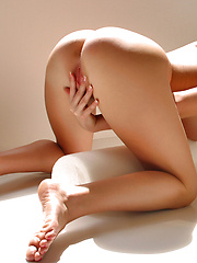 Gorgeous Holly bending over naked playing her tight cherries with her fingers