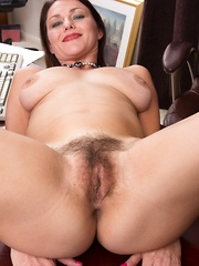 Gina Louise strips by her desk and shows her pussy