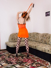 Viola R takes off orange dress and stockings to play