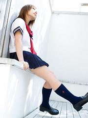Runa Hamakawa Asian plays with her uniform skirt after classes